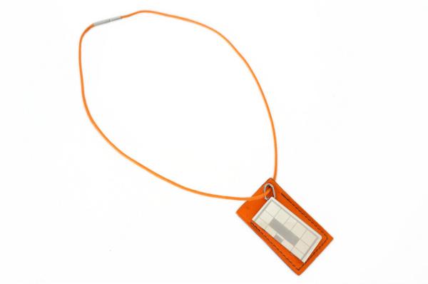エルメス ペアネックレス チョーカー シンボルネックレス プレート 片割れ  オレンジ シルバー