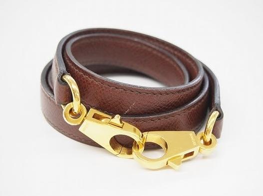 茶色にゴールドの金具がアクセントなエルメス HERMESのバッグ用ショルダーストラップを買取させて頂きました。
